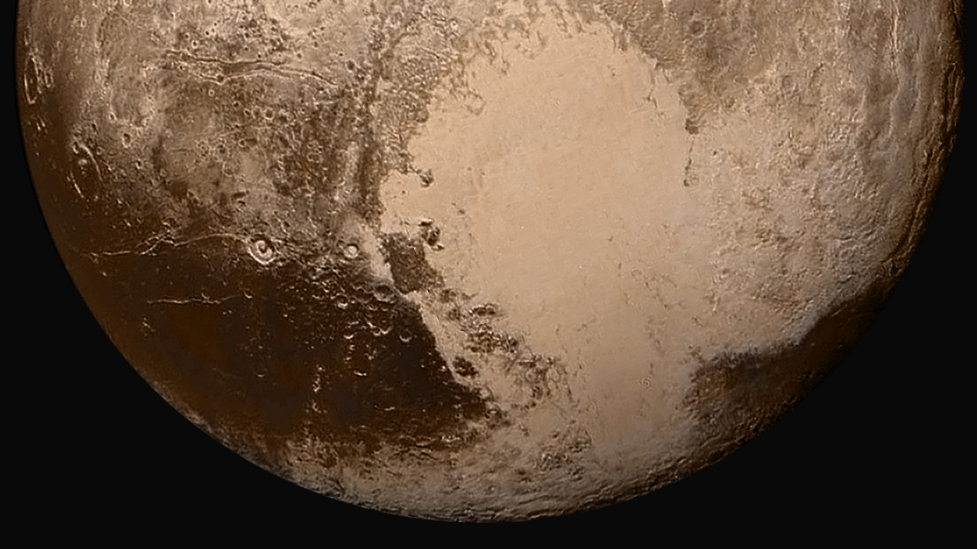 Pluto's Cthulhu region is visible as a dark band at lower left in this image from NASA's New Horizons spacecraft, which made a close flyby of the dwarf planet in July 2015. Image Credit: NASA/JHU-APL/SwRI
