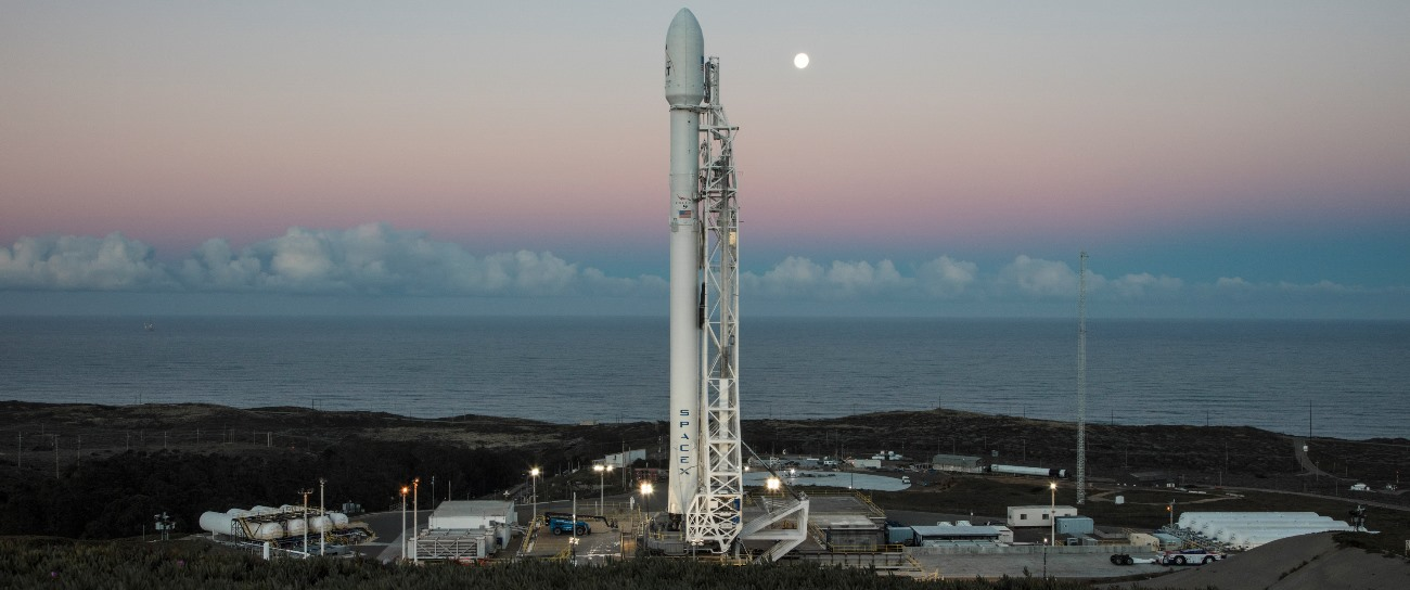 SpaceX's Falcon 9 rocket with 10 Iridium NEXT satellites being prepped for launch from Vandenberg Air Force Base's Space Launch Complex 4E. Photo Credit: SpaceX