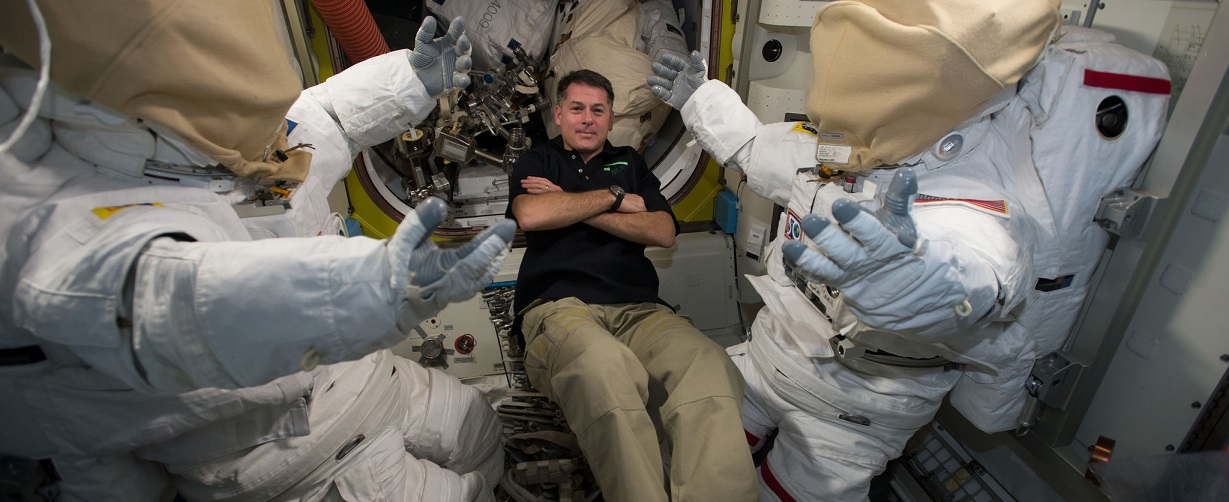 NASA astronaut Shane Kimbrough floats next to two U.S. spacesuits inside the Quest Airlock aboard the International Space Station. The Expedition 50 crew performed routine maintenance on the suits throughout December to prepare for upcoming spacewalks in January 2017 that will see the astronauts work in tandem with external robotics to install six new lithium-ion batteries on the station.