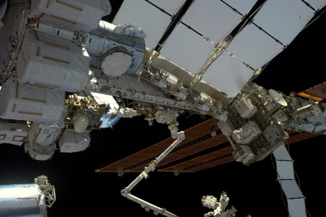 A view of the spacewalk work area for EVA-39 as seen from the Cupola window. The robotic Canadarm2 and Dextre can be seen in the center and bottom of the photo. Photo Credit: Thomas Pesquet / ESA
