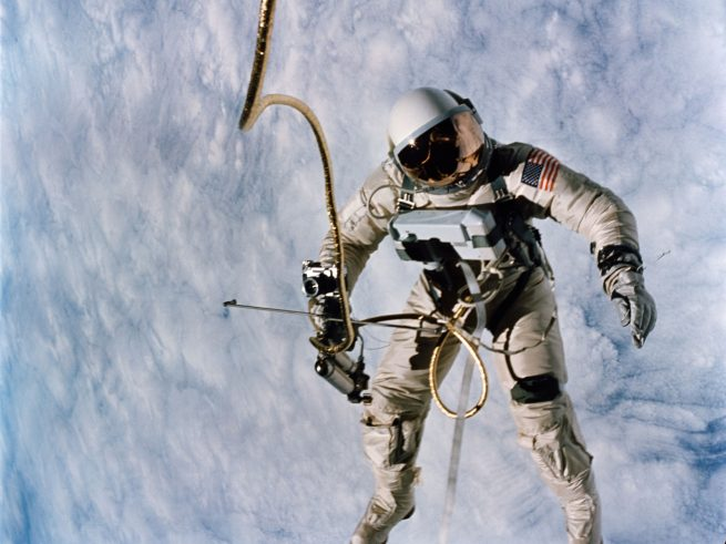 Astronaut Edward H. White, pilot for the Gemini IV spaceflight, floats in space during the first spacewalk by an American.