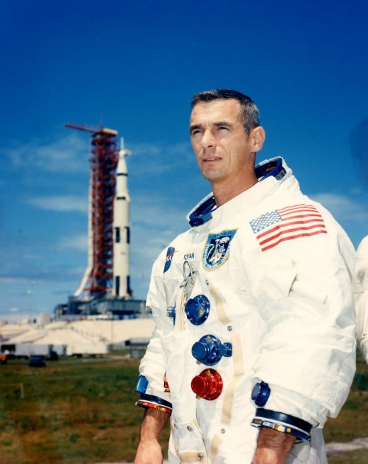 Apollo astronaut Eugene Cernan in front of the Apollo 17 rocket that would take him and his crew to the Moon in December of 1972. Photo Credit: NASA