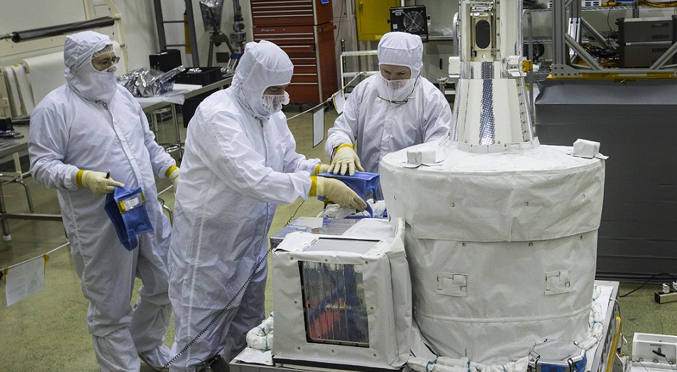 Technicians inside a clean room at NASA's Langley Research Center work on the SAGE III instrument, preparing it to ship to NASA's Kennedy Space Center for launch to the International Space Station. The ozone- and aerosol-measuring instrument is the latest in a long line of atmospheric science experiments designed at NASA Langley.