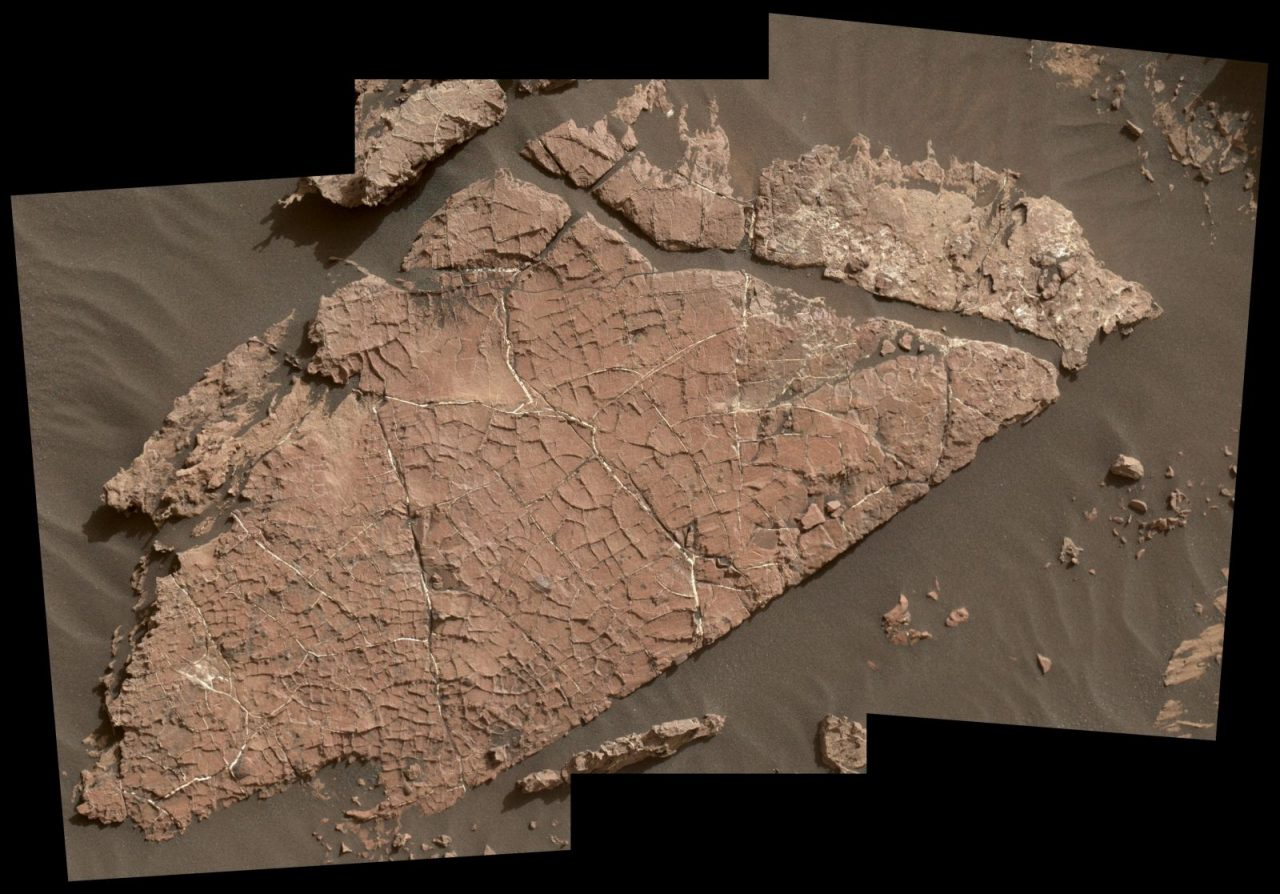 "The network of cracks in this Martian rock slab called ""Old Soaker"" may have formed from the drying of a mud layer more than 3 billion years ago. The view spans about 3 feet (90 centimeters) left-to-right and combines three images taken by the MAHLI camera on the arm of NASA's Curiosity Mars rover. Image Credit: NASA/JPL-Caltech/MSSS"