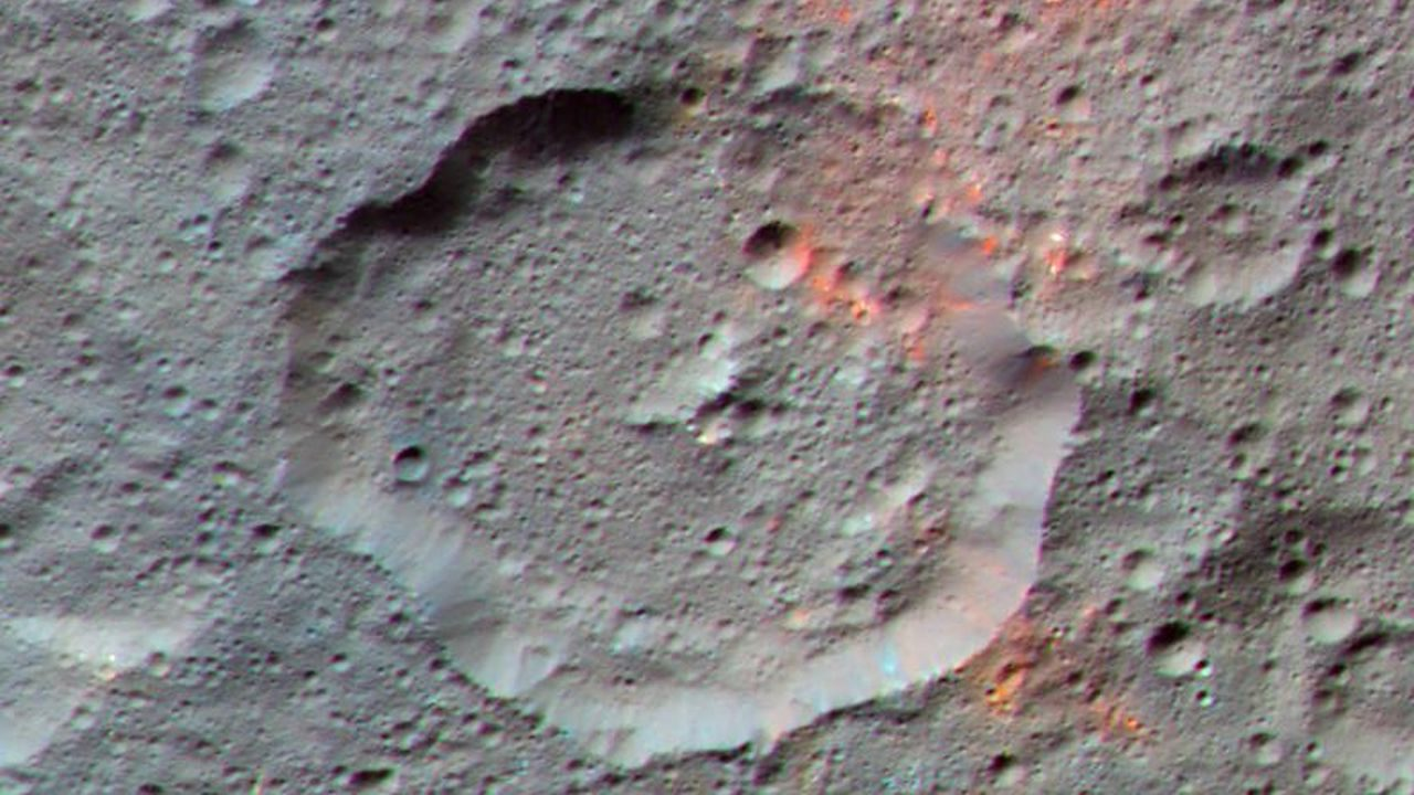 This enhanced color composite image, made with data from the framing camera aboard NASA's Dawn spacecraft, shows the area around Ernutet Crater. The bright red portions appear redder with respect to the rest of Ceres. Image Credit: NASA/JPL-Caltech/UCLA/MPS/DLR/IDA