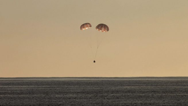 File photo of a previous Dragon capsule descending toward the Pacific Ocean. Photo Credit: SpaceX