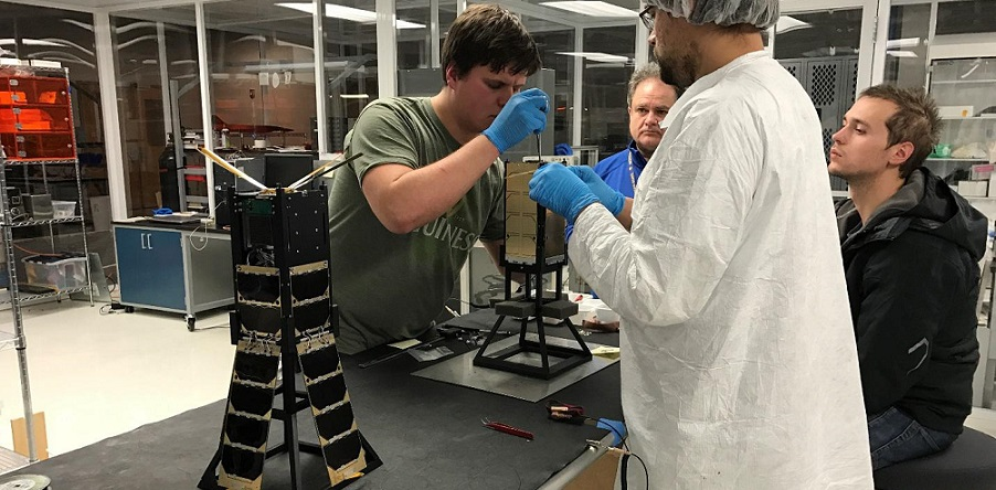 CXBN-2 Integration Team in the Morehead State University Spacecraft Integration and Assembly Facility. Left to right: Yevgeniy Byleborodov, Dr. Ben Malphrus, Michael Glaser-Garbrick and Nate Richard.