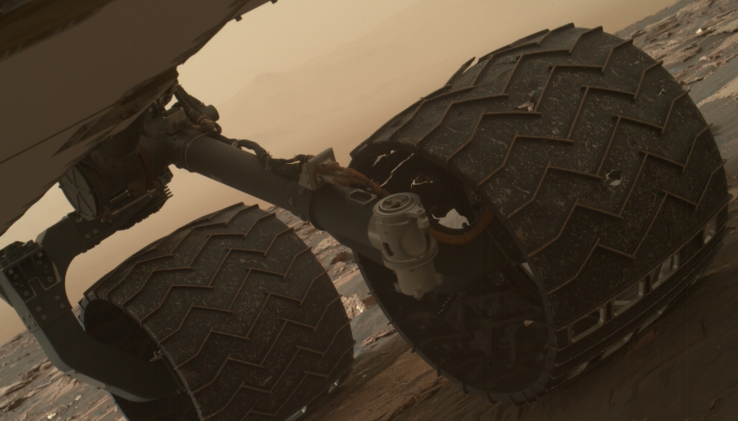 Curiosity broke two of the raised treads, called grousers, on its left middle wheel in the first quarter of 2017. This included the one seen partially detached on the top of the wheel in this image from the rover's Mars Hand Lens Imager (MAHLI) camera on the rover's arm. Photo Credit: NASA/JPL-Caltech/MSSS