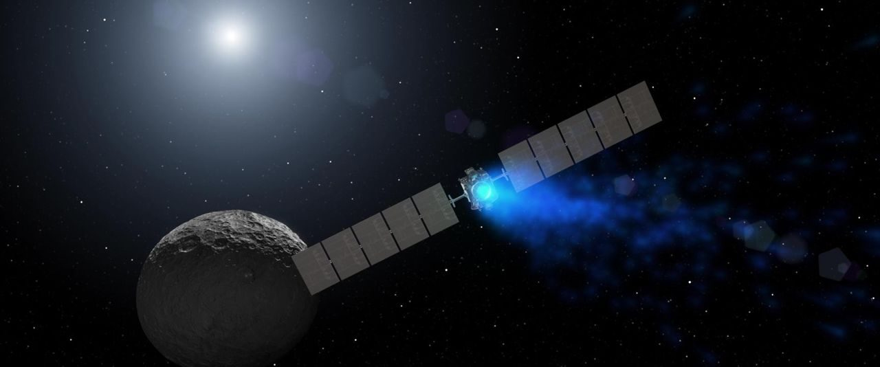 This artist's rendering shows NASA's Dawn spacecraft maneuvering above Ceres with its ion propulsion system. Image Credit: NASA/JPL-Caltech/UCLA/MPS/DLR/IDA