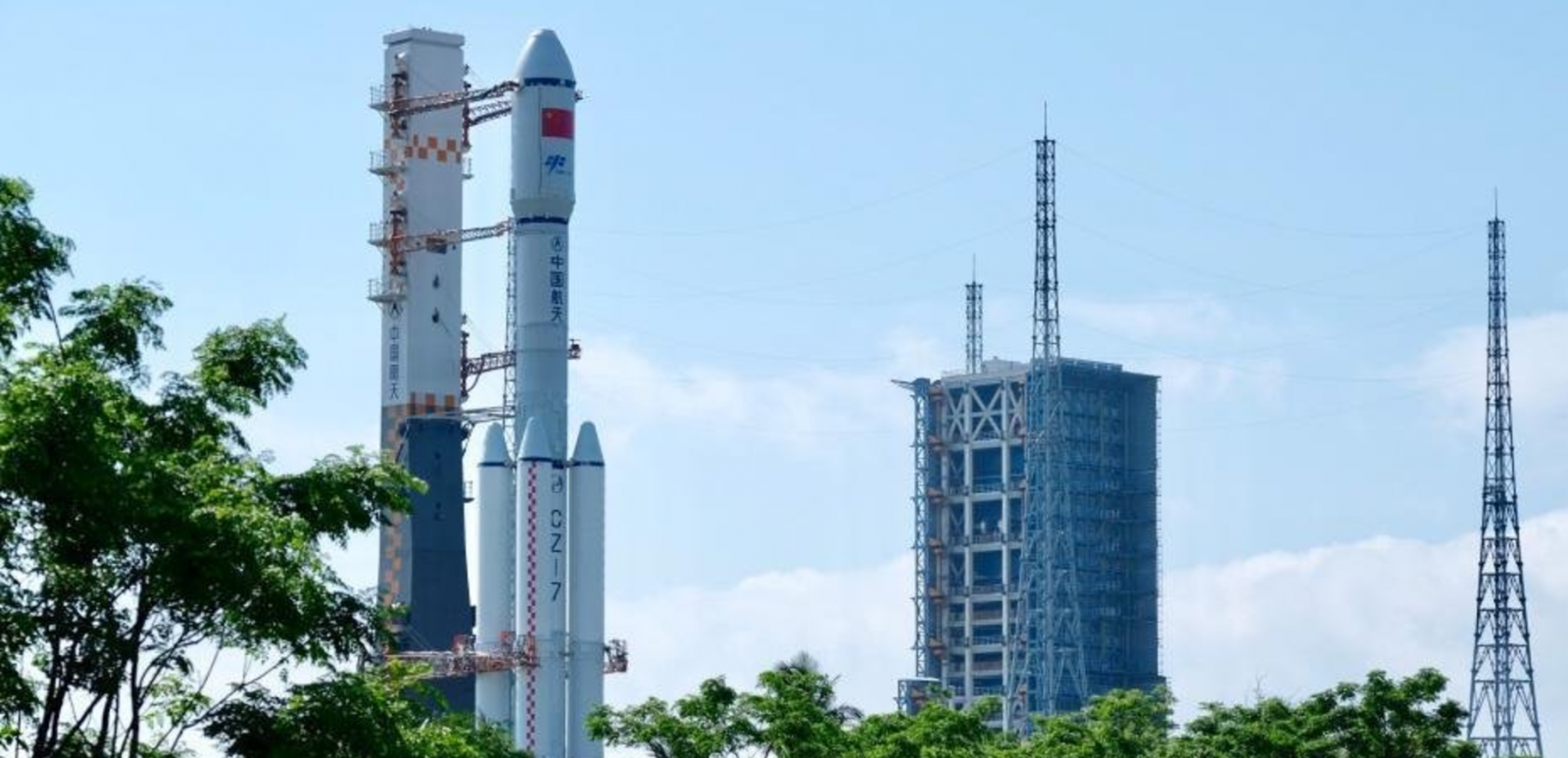 China's Long March 7 rocket, carrying the Tianzhou-1 resupply spacecraft, is rolled-out to the pad at the Wenchang Satellite Launch Center. Photo credit: Chinanews.com