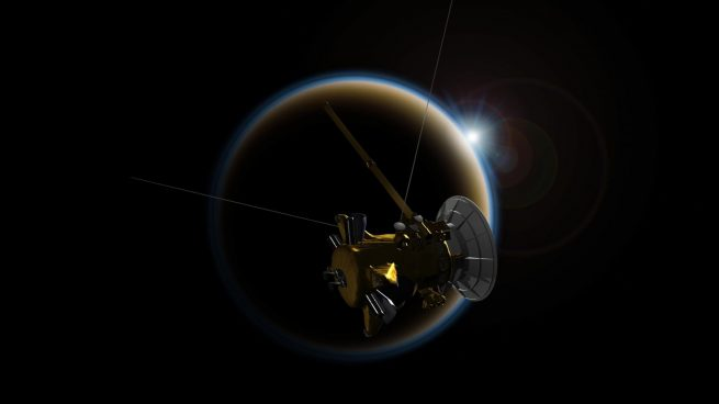 An artist's rendering of Cassini making its final close flyby of Saturn's moon Titan on April 21, 2017, using its radar to reveal the moon's surface lakes and seas one last time. Image Credit: NASA/JPL-Caltech