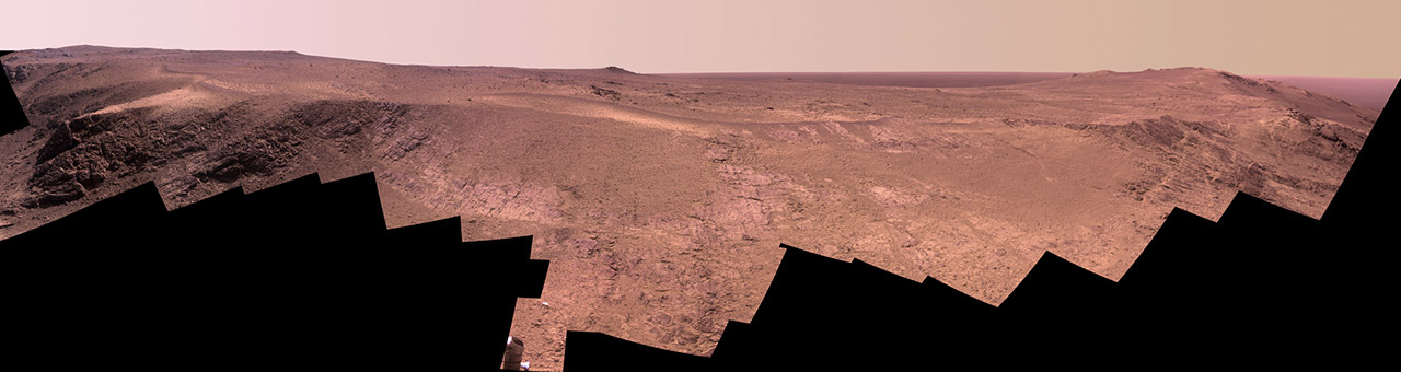"A grooved ridge called ""Rocheport"" on the rim of Mars' Endeavour Crater spans this scene from the Pancam on NASA's Mars rover Opportunity. The view extends from south-southeast on the left to north on the right. The site is near the southern end of an Endeavour rim segment called ""Cape Tribulation."" Image Credit: NASA/JPL-Caltech/Cornell Univ./Arizona State Univ"