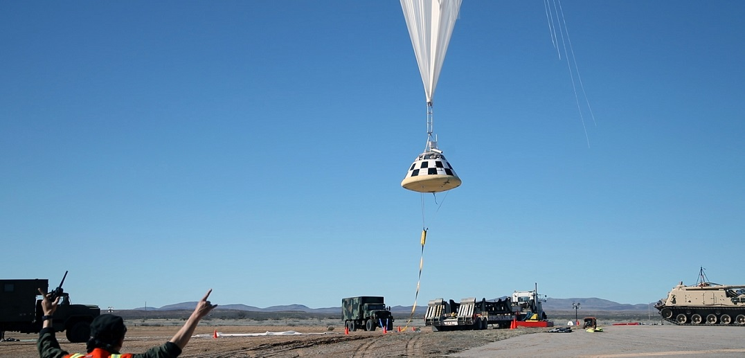 A high-altitude balloon lifts off in White Sands, New Mexico, carrying a boilerplate of Boeing's CST-100 Starliner to perform a drop test of the spacecraft's parachute system.