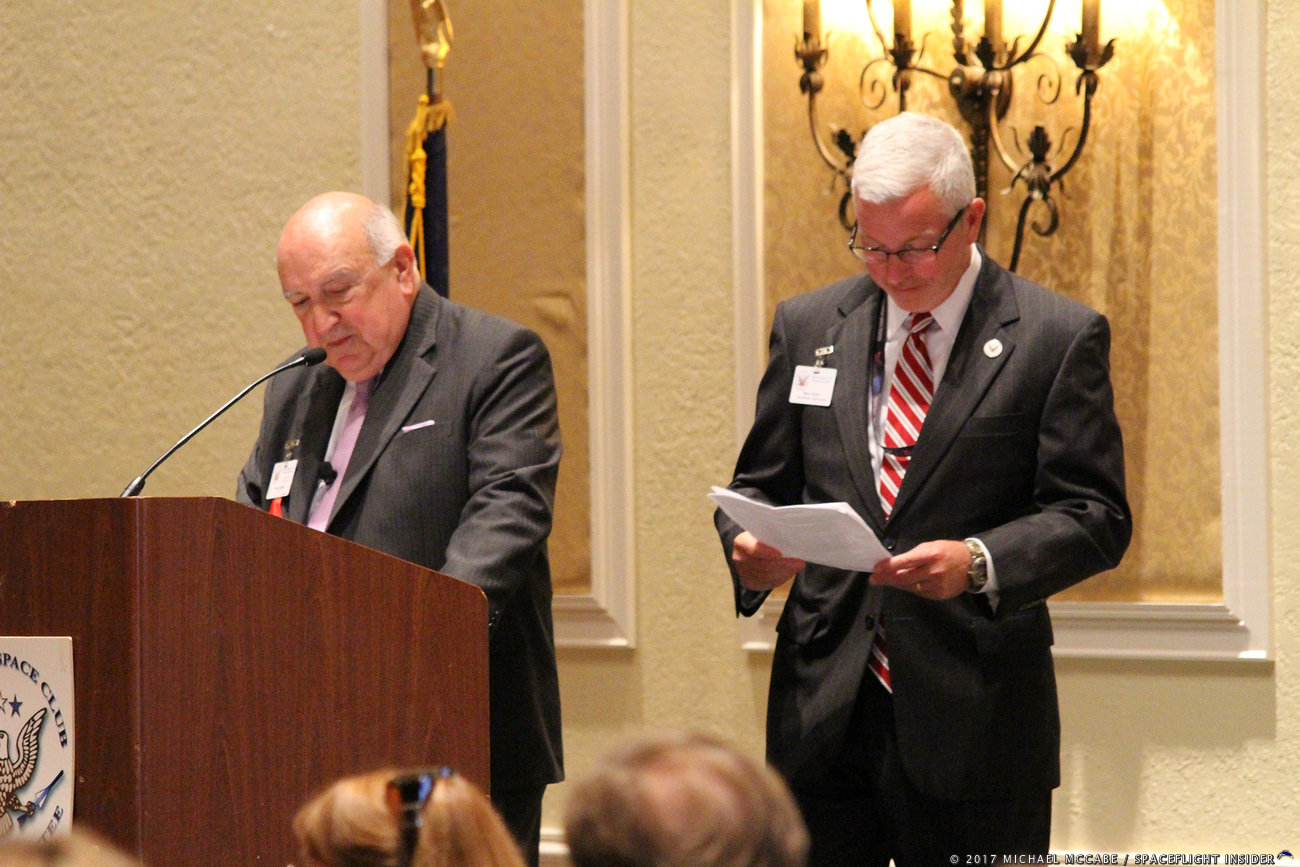 Space Florida's President and CEO, Frank DiBello,(left) begins his remarks during the National Space Club Florida's (NSCFL) spring luncheon, held on Tuesday, May 9. He was introduced by the NSCFL's Mark Patton (right). Photo Credit: Michael McCabe / SpaceFlight Insider