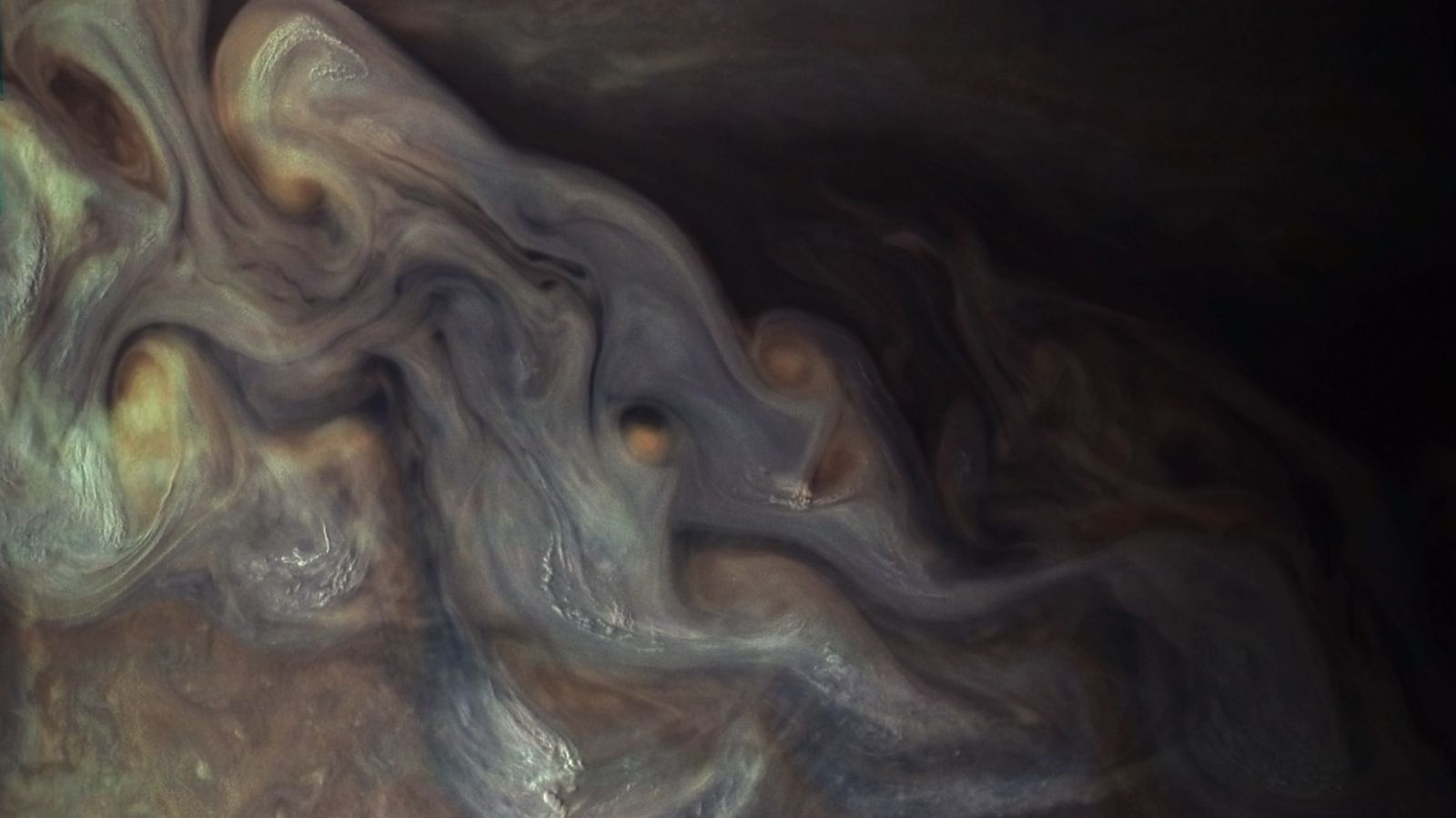 A view of Jupiter's clouds from the Juno spacecraft orbiting the gas giant. Photo Credit: NASA