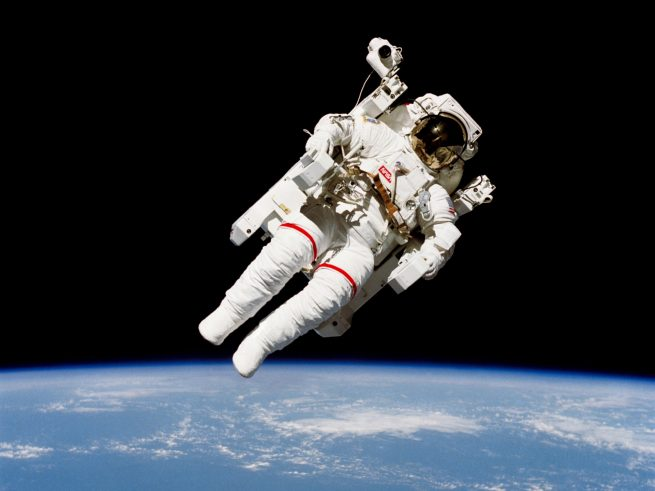 Astronaut Bruce McCandless orbits in jetpack