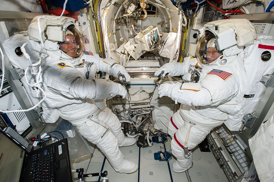 Jack Fischer, left, and Peggy Whitson are suited up for EVA-42, their previous spacewalk, which occurred May 12, 2017. Photo Credit: NASA