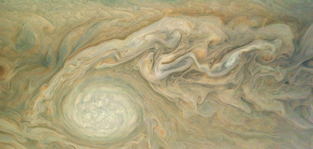 This enhanced color view of Jupiter's cloud tops was processed by citizen scientist Bjorn Jonsson using data from the JunoCam instrument on NASA's Juno spacecraft. The image highlights a massive counterclockwise rotating storm that appears as a white oval in the gas giant's southern hemisphere. Image Credit: NASA/JPL-Caltech/SwRI/MSSS/Bjorn Jonsson