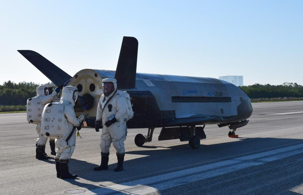 Engineer's in Hazmat suits begin the process of safing the X-37B after landing. Photo Credit: U.S. Air Force