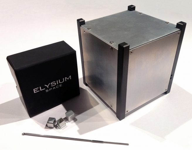 A size comparison of the small cremation container and the CubeSat. Photo Credit: Elysium Space