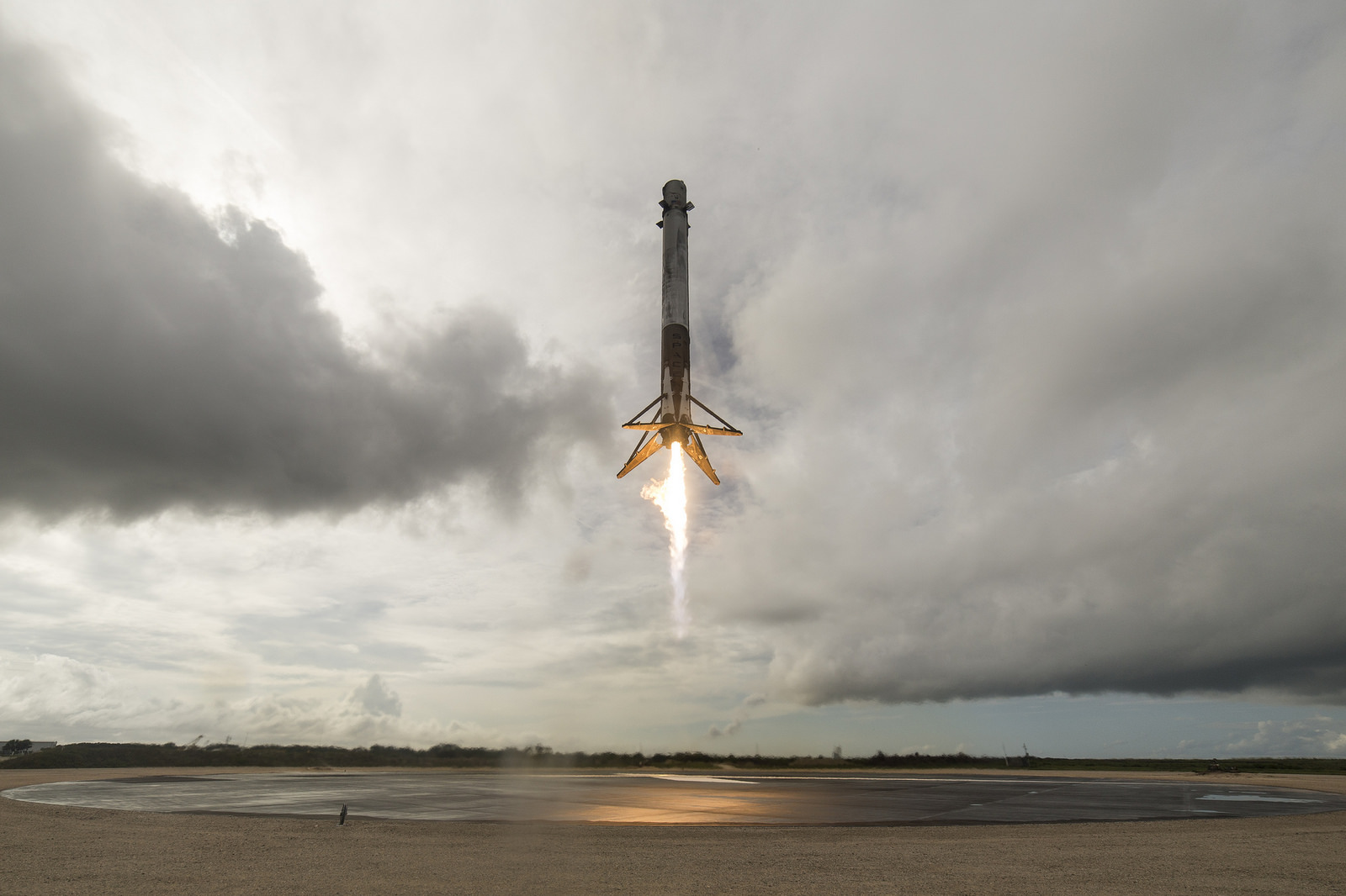 The Falcon 9 (CRS-11 Dragon mission) first stage returning to Earth