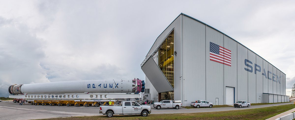 Falcon 9 core 1029 arrives at SpaceX's horizontal integration hangar just outside Kennedy Space Center's Launch Complex 39A to be integrated with the second stage in advance of the BulgariaSat-1 mission. Photo Credit: SpaceX