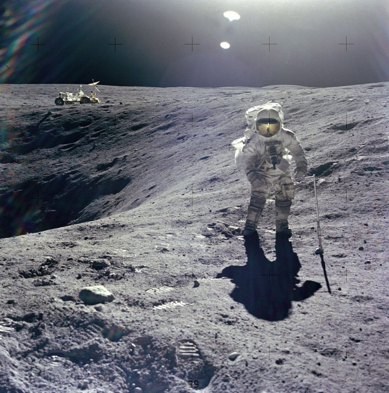 Apollo 16 astronaut Charles Duke standing on the rim of Plum crater, which is 131 feet (40 meters) in diameter and about 33 feet (10 meters) deep. Image Credit: NASA