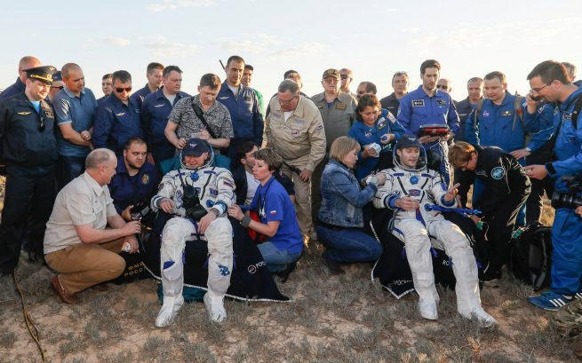 After being extracted from Soyuz MS-03, Oleg Novitskiy, left, and Thomas Pesquet were taken to couches for initial health checks and water. Photo Credit: Roscosmos