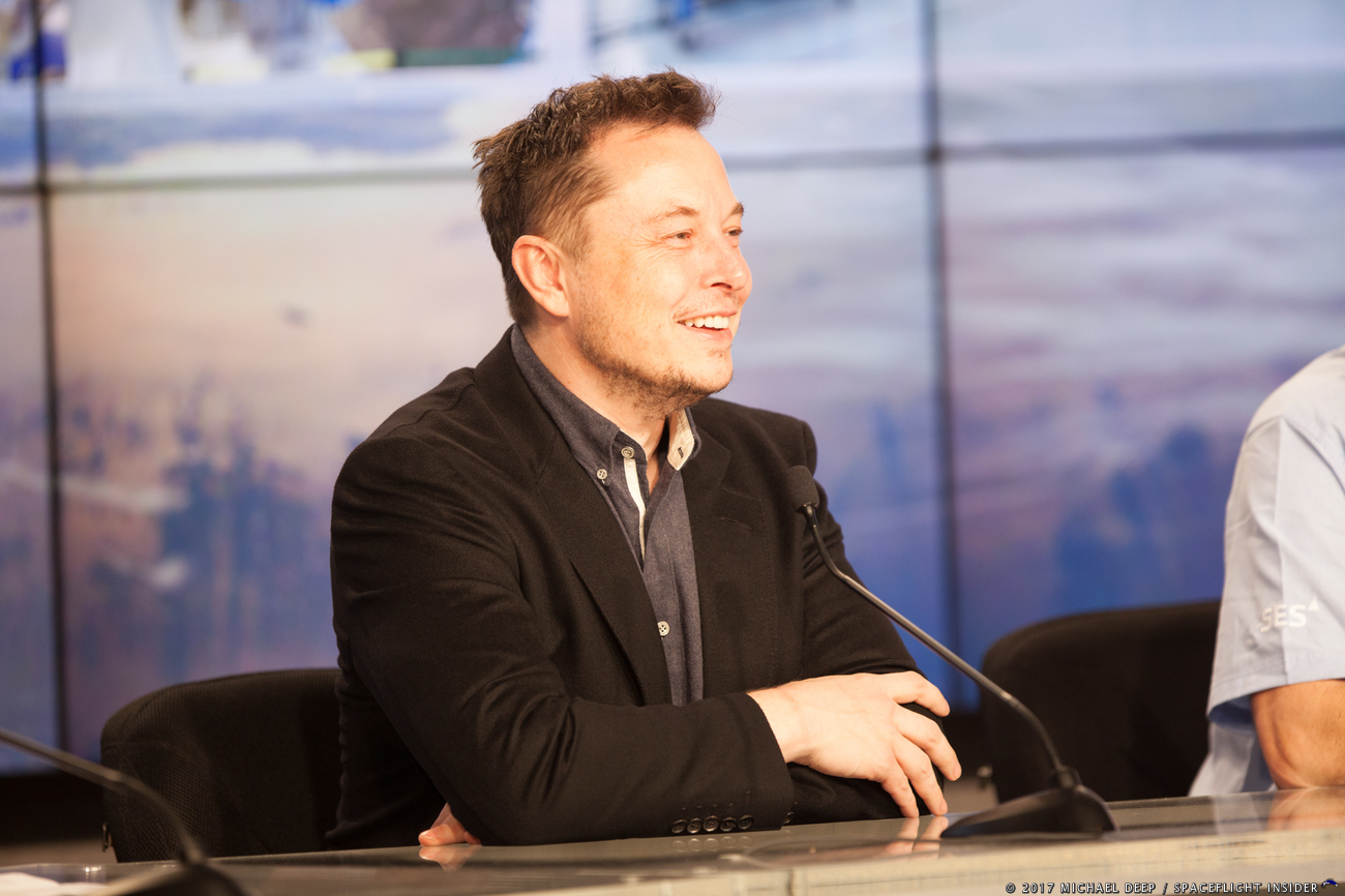 SpaceX CEO and Chief Designer Elon Musk smiles during press conference at NASA's Kennedy Space Center in Florida. Photo Credit: Mike Deep / SpaceFlight Insider