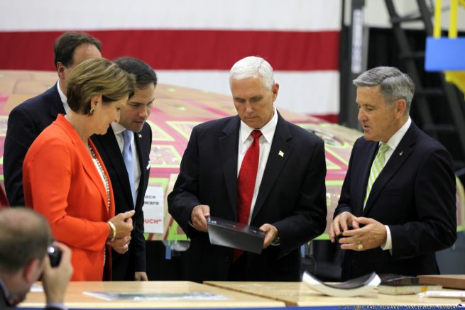 U.S. Vice President Mike Pence is show pieces of the Orion spacecraft's heat shield by NASA KSC Administrator Robert Cabana and Lockheed Martin's CEO Marillyn Hewson. Pence was joined by Florida Senator Marco Rubio. Photo Credit: Mike Howard / SpaceFlight Insider