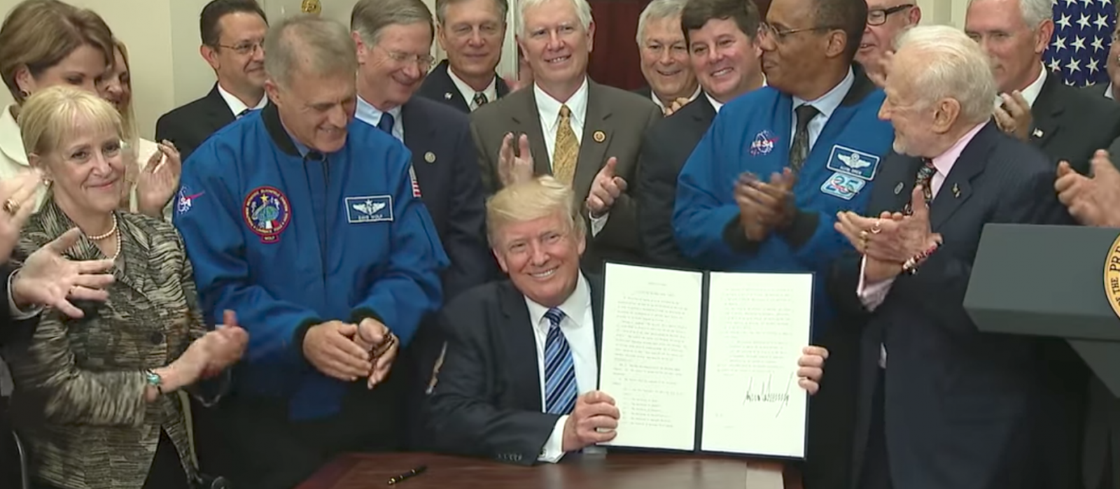 President Trump displays the Executive Order authorizing the reinstatement of the National Space Council.