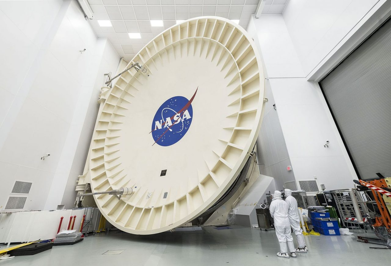 Engineers watch as Chamber A's colossal door closes at NASA's Johnson Space Center in Houston. Photo Credit: NASA/Chris Gunn