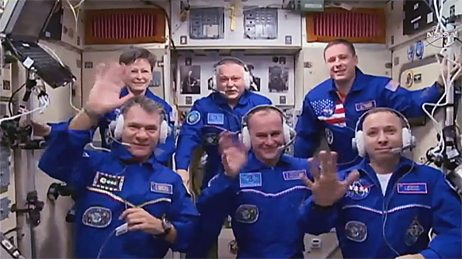 The full Expedition 52 meets in the Zvezda service module for a post-docking conference with friends and family