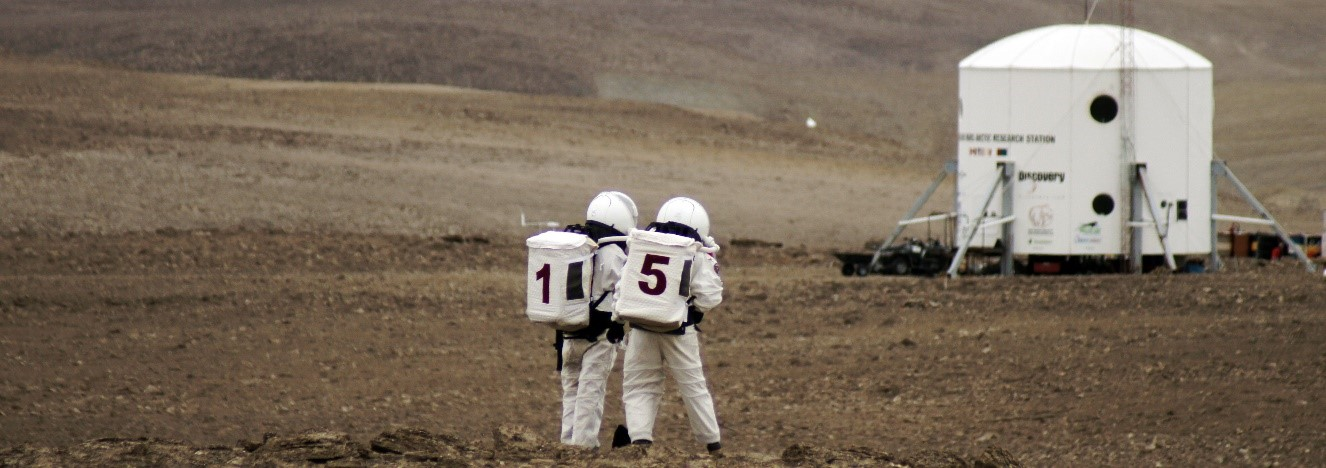 Two members of the Mars 160 mission during an extravehicular activity at the Mars Society's Flashline Mars Analogue Research Station. Photo Credit: Mars Society