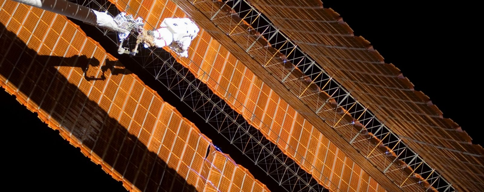NASA astronaut Scott Parazynski conducts an unplanned EVA to repair a damaged solar array on the International Space Station during STS-120. Photo Credit: NASA