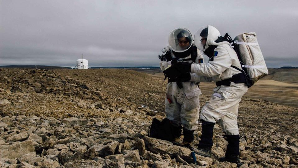 Two crew members on the Mars 160 mission conduct an in-simulation extravehicular activity. Photo Credit: Mars Society