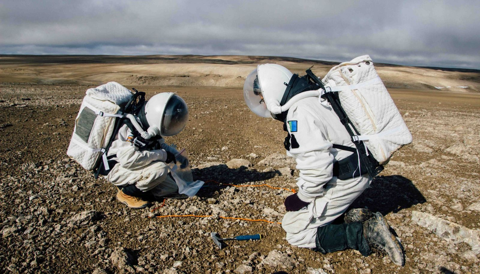 Two Mars 160 crew members collect samples to analyze. Photo Credit: Paul Knightly / Mars Society