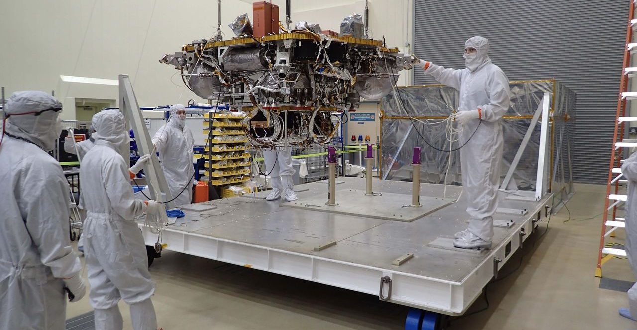 The Mars lander portion of NASA's InSight spacecraft is lifted from the base of a storage container in preparation for testing, in this photo taken June 20, 2017, in a Lockheed Martin clean room facility in Littleton, Colorado. Photo Credit: NASA/JPL-Caltech/Lockheed Martin