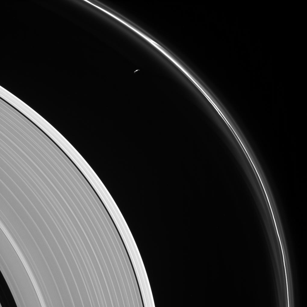 The thin sliver of Saturn's moon Prometheus lurks near ghostly structures in Saturn's narrow F ring in this view from NASA's Cassini spacecraft. Many of the narrow ring's faint and wispy features result from its gravitational interactions with Prometheus (86 kilometers, or 53 miles across). Photo & Caption Credit:NASA/JPL-Caltech/Space Science Institute