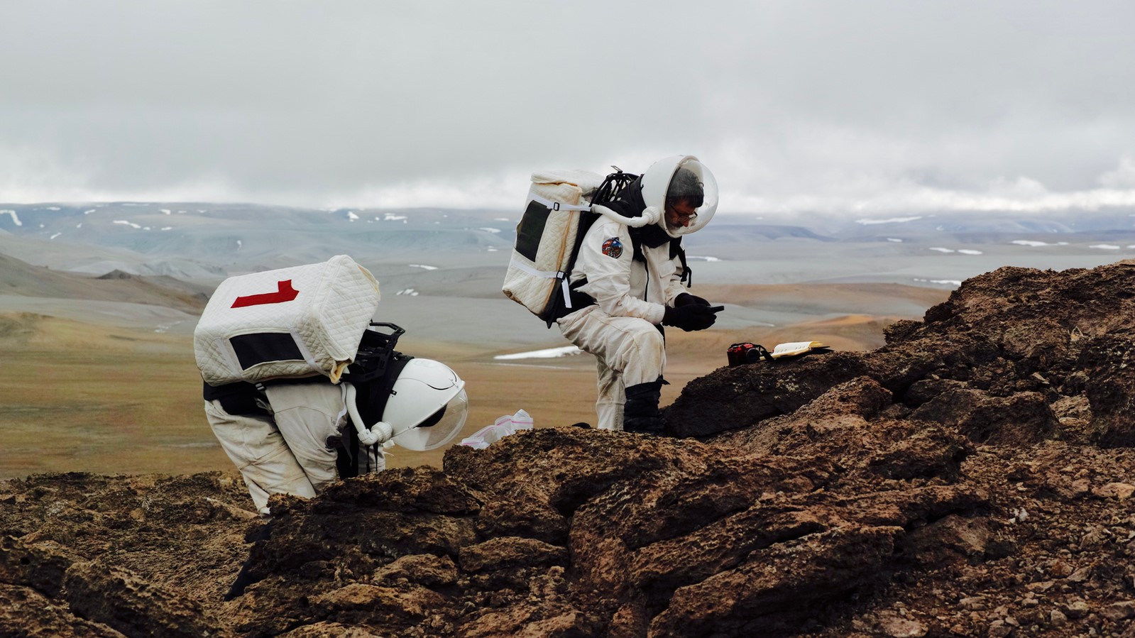 Two crew members of the Mars 160 mission perform a simulated EVA. Photo Credit: Mars Society