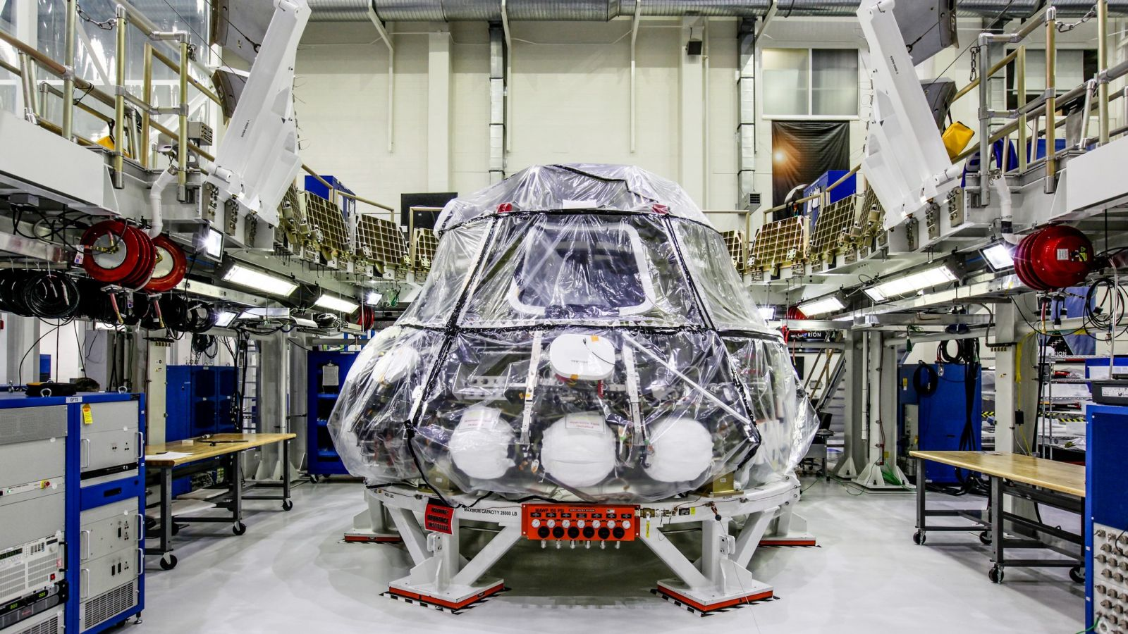 NASA's Orion spacecraft as seen at the Kennedy Space Center's Neil Armstrong Operations and Checkout Building. Engineers recently completed a power-on test in advance of the first integrated flight atop the space agency's Space Launch System rocket. The EM-1 mission is slated for sometime in 2019. Photo Credit: Leif Heimbold / NASA