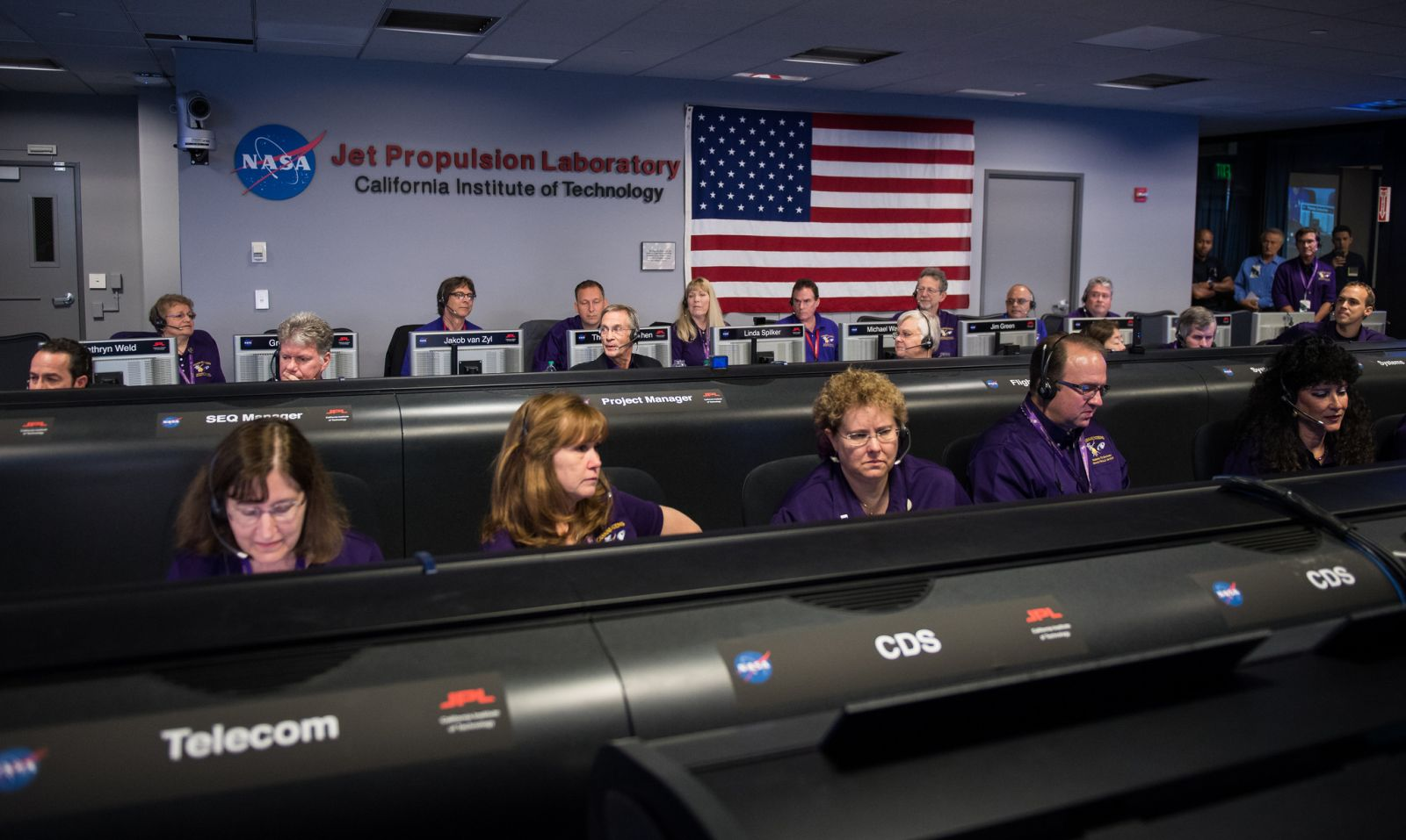Cassini program manager at JPL, Earl Maize, center row, calls out the end of the Cassini mission. Photo and Caption Credit: Joel Kowsky / NASA