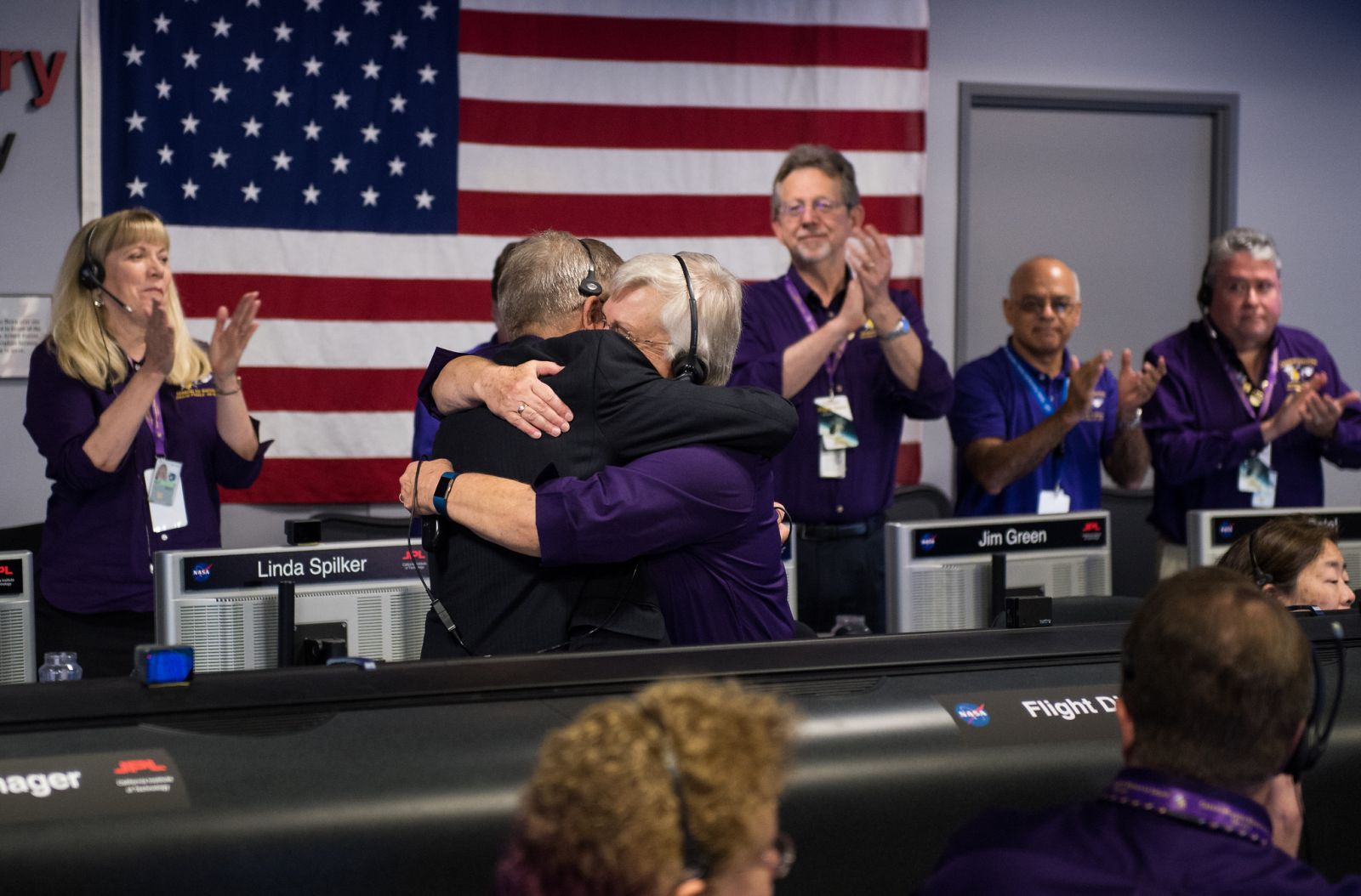 Earl Maize, left and Julie Webster embrace after Cassini plunged into Saturn. Photo Credit: Joel Kowsky / NASA