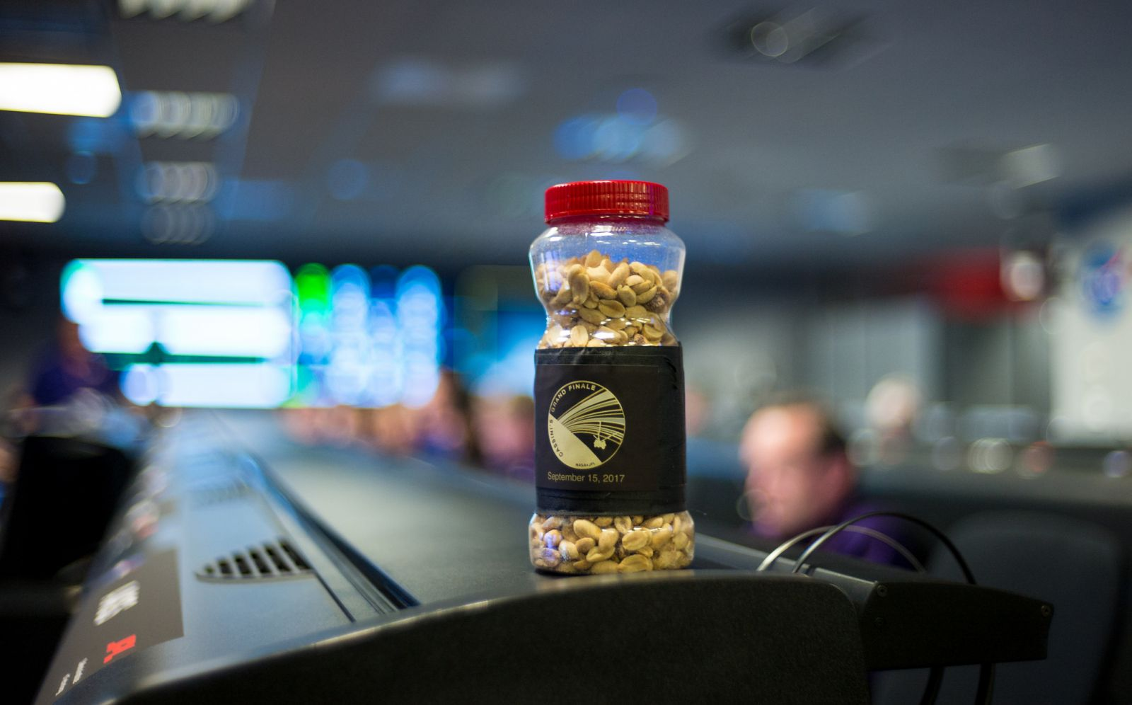 A jar of peanuts on a console in mission control of the Space Flight Operations Center as the Cassini mission team await the final downlink of the spacecraft's data recorder. Eating peanuts before a major mission event is tradition at JPL. Photo Credit: Joel Kowsky / NASA