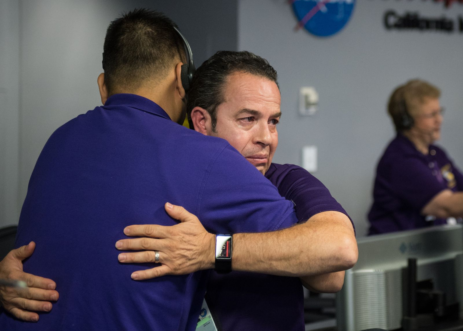 Cassini team mebers embrace after the spacecraft was deliberately plunged into Saturn. Photo and Caption Credit: Joel Kowsky / NASA
