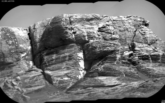 "This view of ""Vera Rubin Ridge"" from the ChemCam instrument on NASA's Curiosity Mars rover shows sedimentary layers and fracture-filling mineral deposits. Image Credit: NASA / JPL-Caltech / CNES / CNRS / LANL / IRAP / IAS / LPGN"