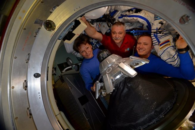 Peggy Whitson, Fyodor Yurchinkhin, and Jack Fischer pose for one last photo before hatch closure. Photo Credit: NASA