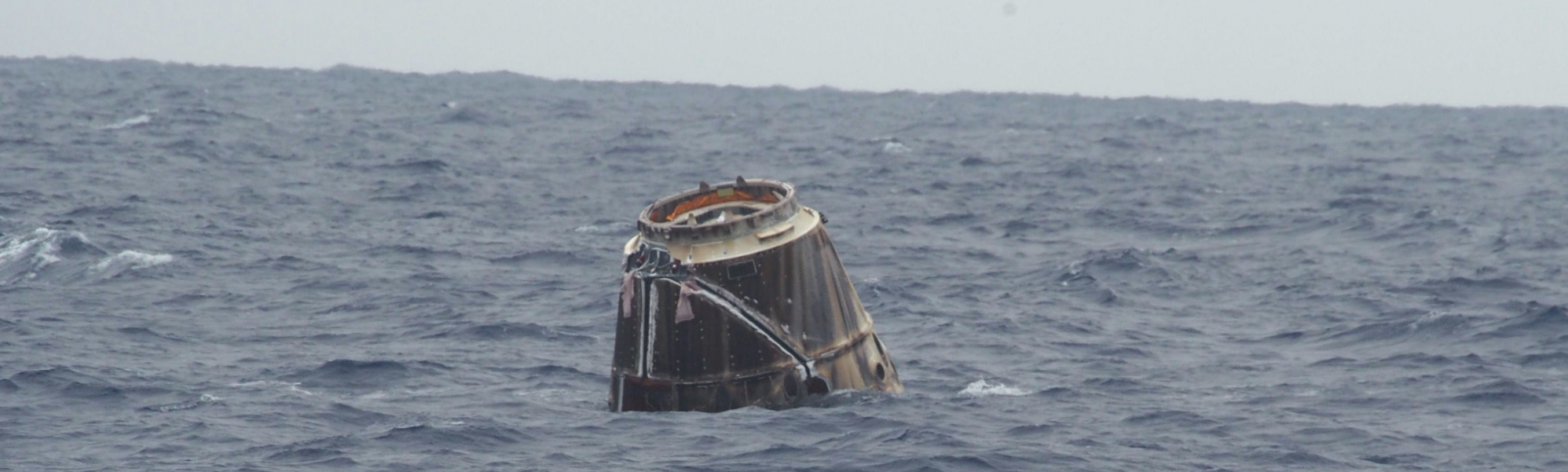 File photo of SpaceX's Dragon spacecraft as it floats in the Pacific Ocean after its first successful test flight in 2012. Photo Credit: Michael Altenhofen / SpaceX
