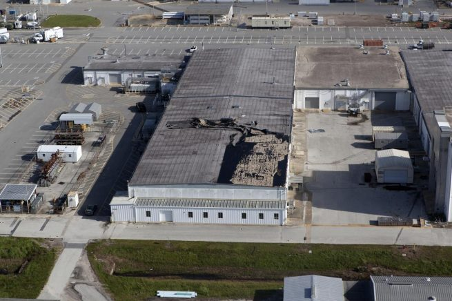 The roof on this industrial building behind the Space Station Processing Facility at KSC appears to have sustained minor damage after Hurricane Irma lashed the center with high winds. Photo credit: NASA / Bill White