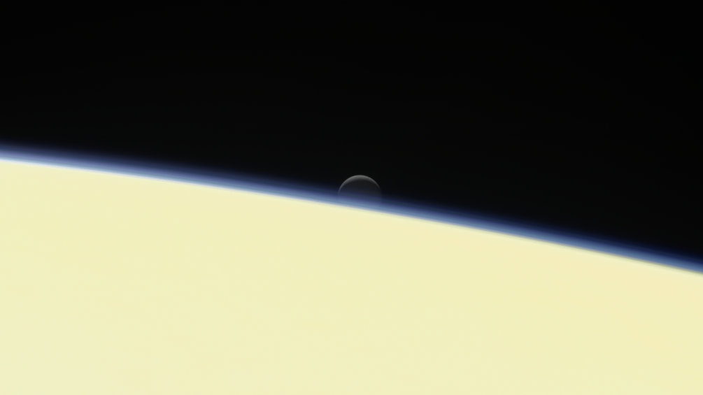 A view of Enceladus as it set behind Saturn. This was among the final images Cassini took in the Saturnian system before its fiery demise. Photo Credit: NASA / JPL